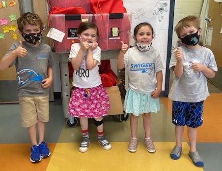 Nora and her classmates with Activity Care Bags they made